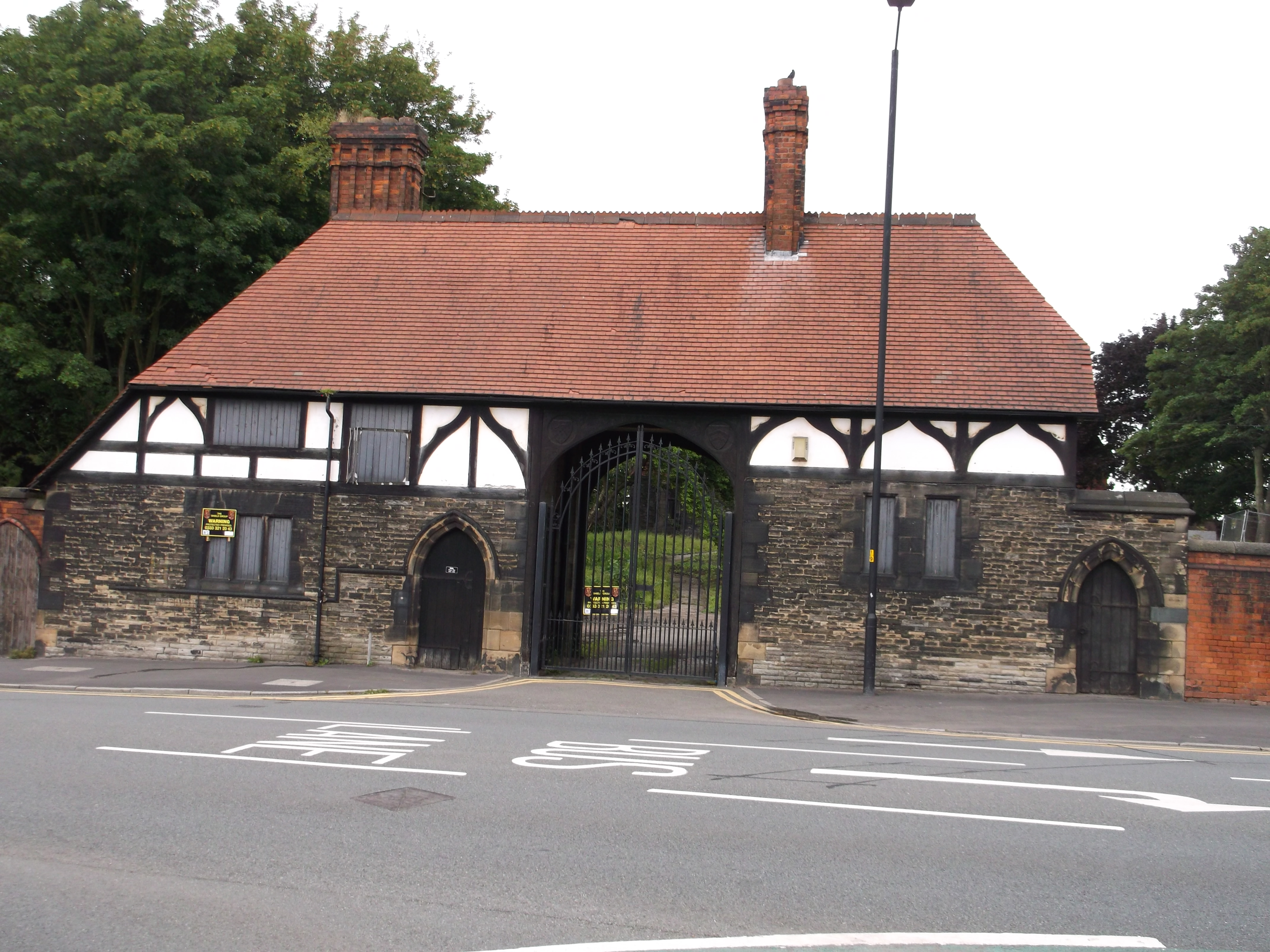 Gatehouse to Wigan Hall with attached boundary wall
