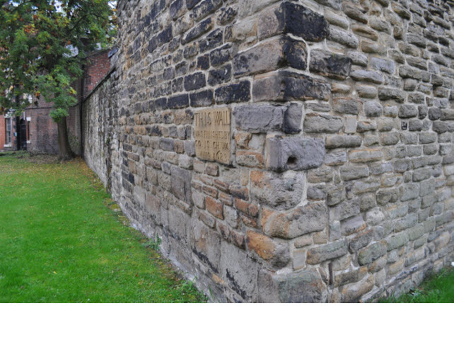 Section of wall bounding All Saints Church Yard on South