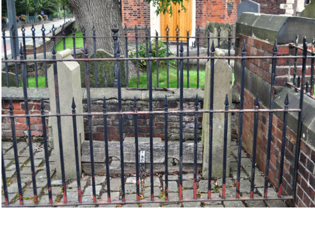 Village Stocks against St Lukes churchyard wall